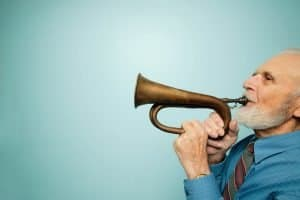 Music and Alzheimer's, older man playing the trumpet