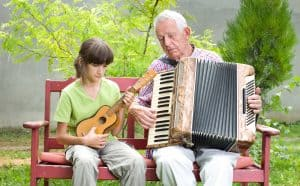 music and Alzheimer's, man playing a musical instrument with young girl
