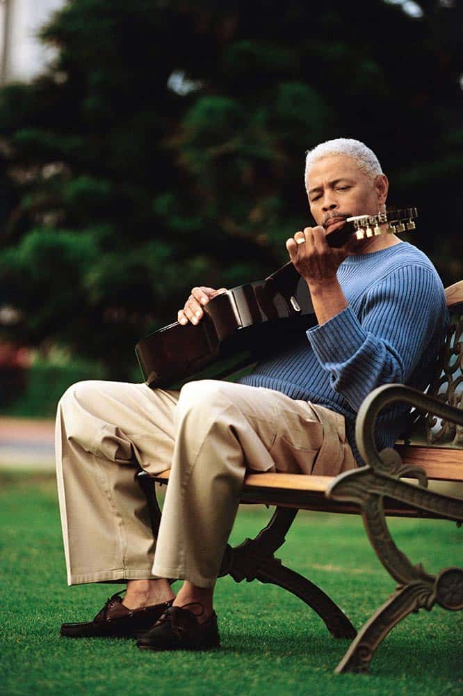 music and alzheimer's; man playing guitar