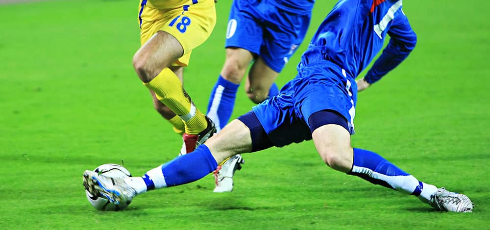 music and sports; soccer players on the field