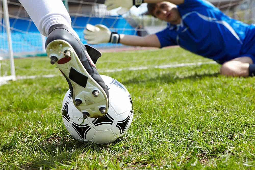 music and sports, soccer player kicking a ball into the goal