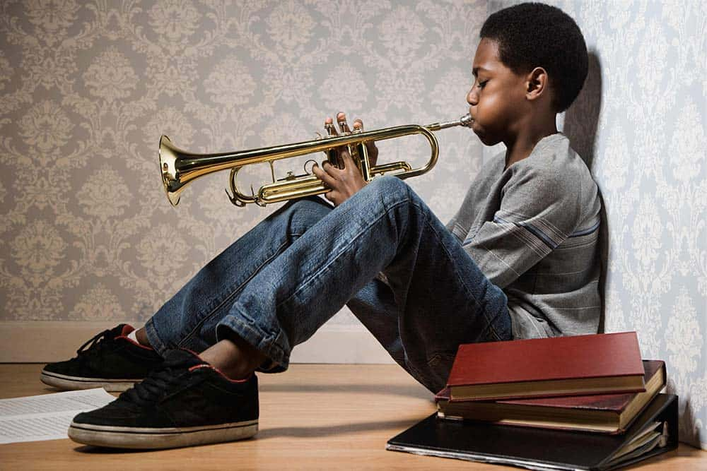 musical talent; boy playing trumpet