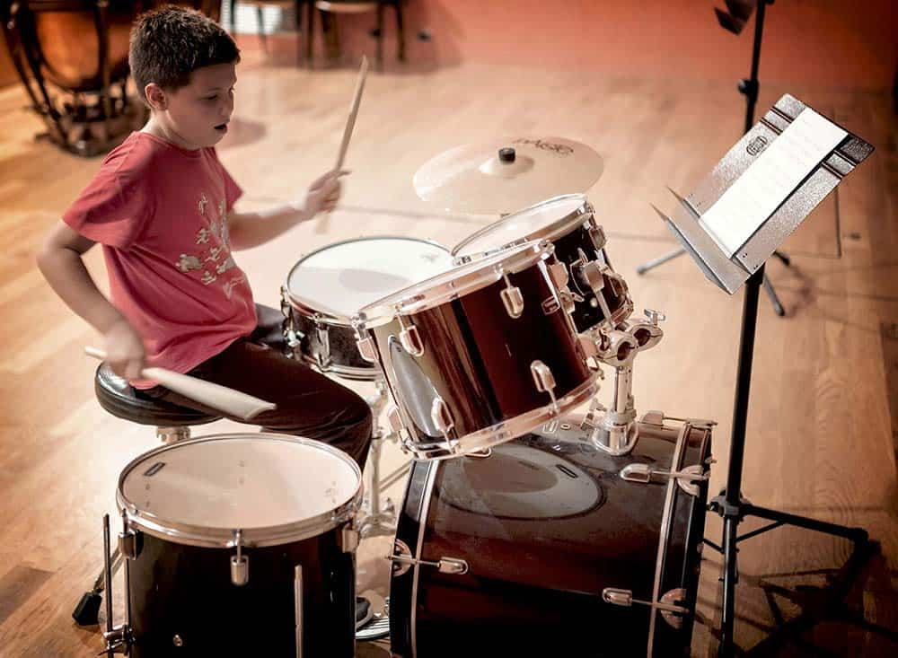 musical talent, boy playing drums