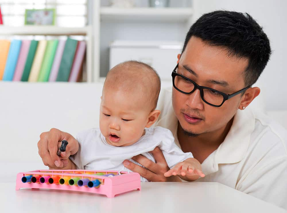 musical talent, father and baby playing the xylophone