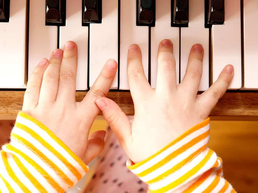 musical talent, children's fingers on piano keyboard