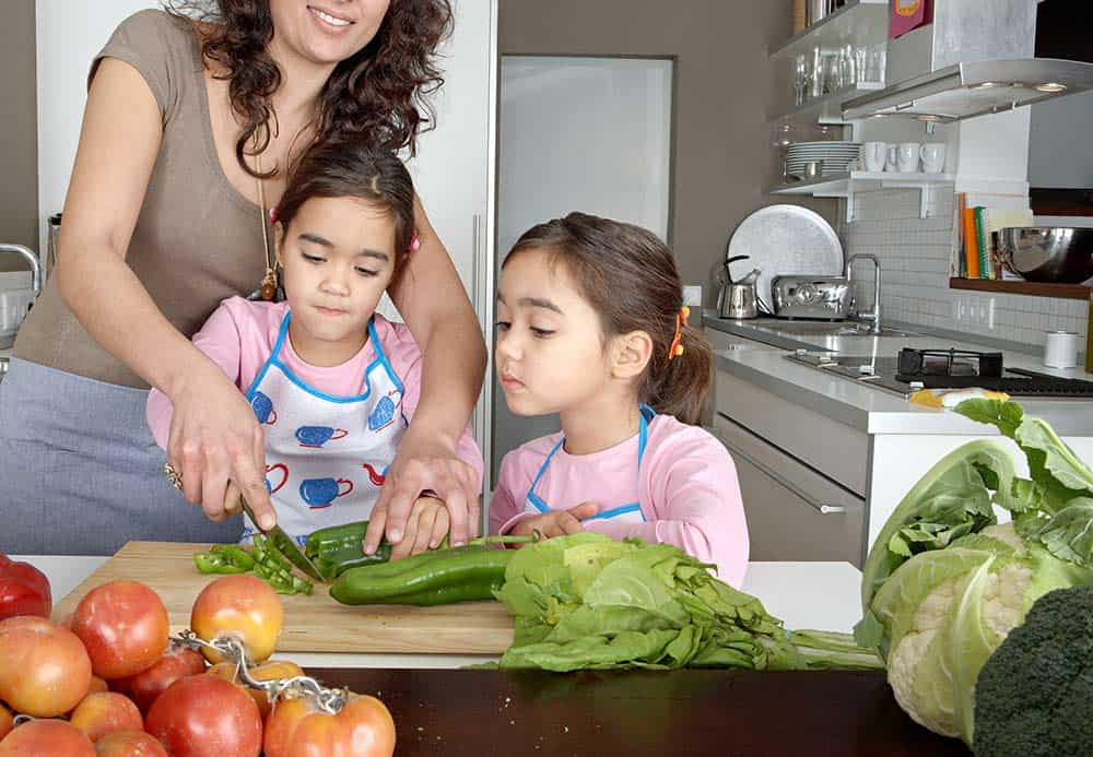 children making an award-winning quiche in the kitchen with their mom