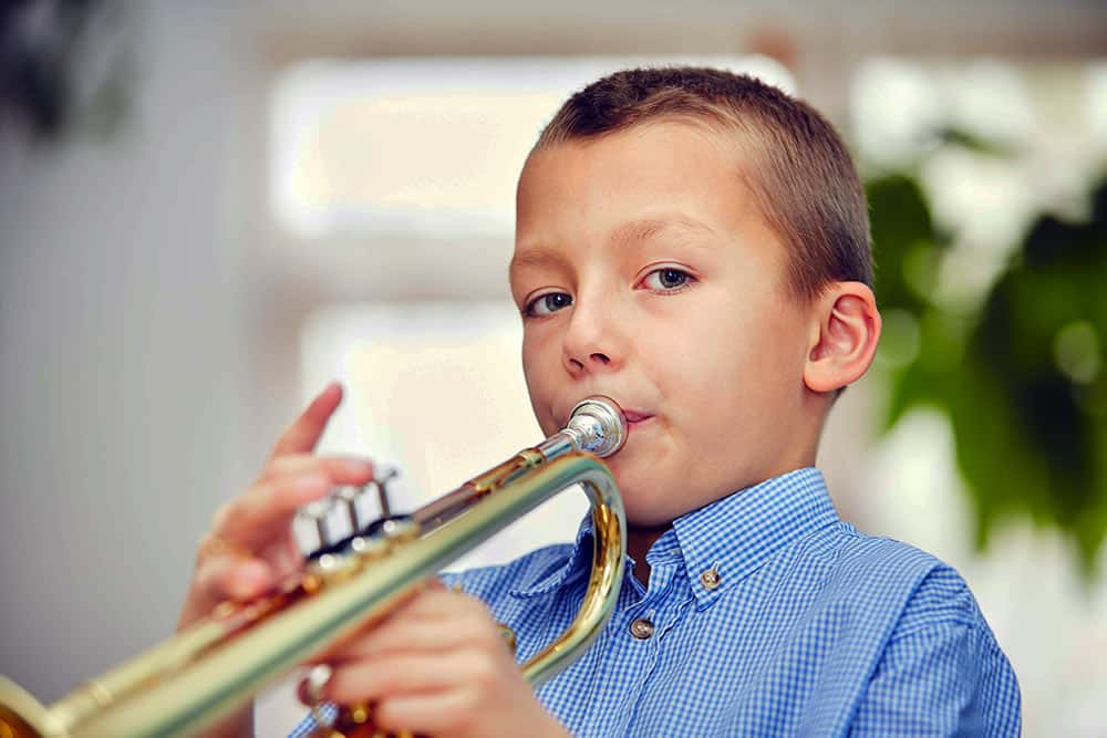 learning disabilities, child playing trumpet
