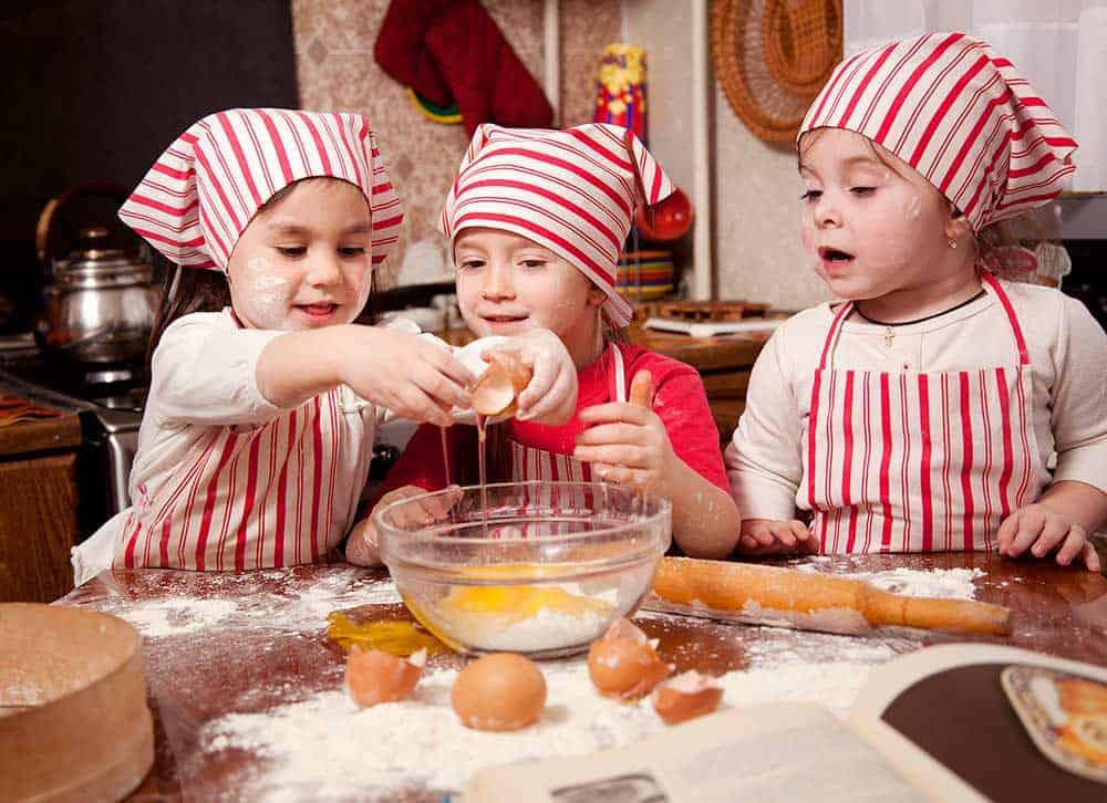 best Christmas books, children making Christmas cookies